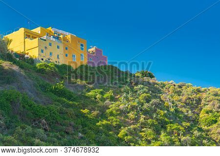 View On Mountain And Colorful Buildings On The Top In Punta Brava, Puerto De La Cruz, Tenerife, Cana