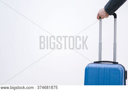 Luggage Rules Concept. Cropped Shot Of Hand Holding A Suitcase Packed According To All The Rules And