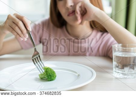 Woman On Dieting. Depressed Teen Looking At Her Empty Plate Dinner.