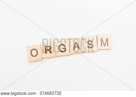 Inscription Orgasm Made Of Letters On Wooden Blocks. Sex Education Concept