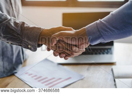 Two Businessmen Handshaking In Meeting After Final Project Agreement Deal Done.