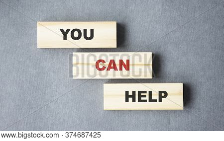 We Can Help - Phrase On Wooden Blocks With Letters, Mutual Assistance Companionship Concept.