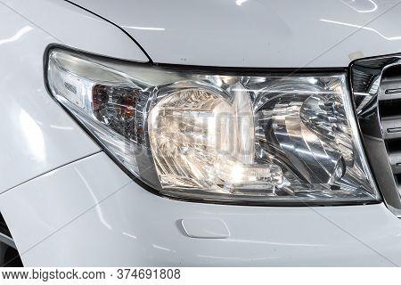 Novosibirsk/ Russia - June 15  2020:  Toyota Land Cruiser 200, White Car Headlights. Exterior Detail