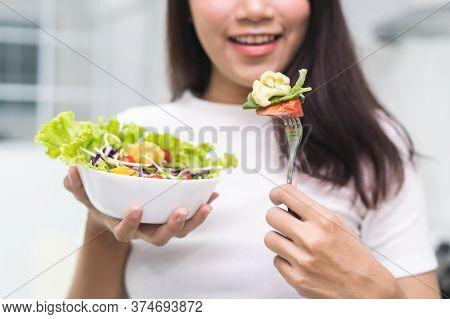 Eat Green For Wellness. Young Girl Enjoy Eating Vegan.