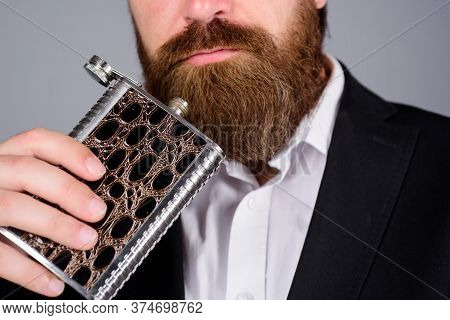 Bearded Man Holds Hip Flask With Alcohol And Booze. Hipster In Suit Hold Metal Flask For Alcohol. Al