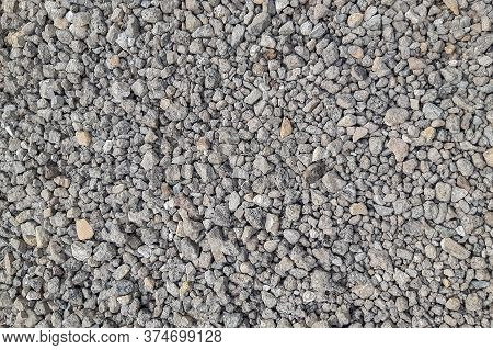 The Background Is Fine Grey Gravel And Rubble