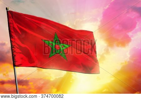 Fluttering Morocco Flag On Beautiful Colorful Sunset Or Sunrise Background. Morocco Success And Happ