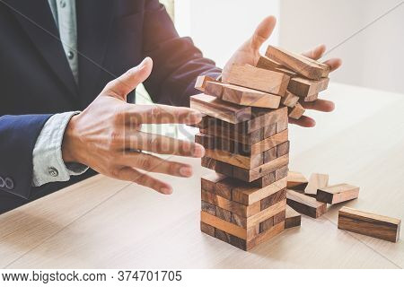Business Failure Concept. Businessman Built Block Tower And Tower Are Failure.