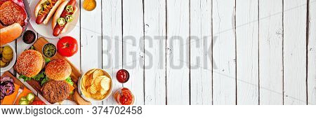 Summer Bbq Food Table Scene With Hot Dog And Hamburger Buffet. Above View Corner Border Over A White