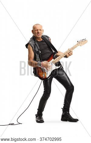 Full length portrait of a punk rocker playing an electric guitar isolated on white background