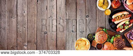 Summer Bbq Food Corner Border With Hot Dog And Hamburger Buffet. Top View Over A Dark Wood Banner Ba
