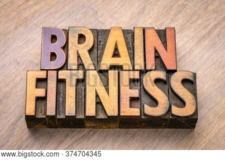 brain fitness word abstract in vintage letterpress wood type, exercise your brain and mental health concept