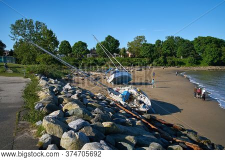 Vancouver, British Columbia, Canada - May 24, 2017. Sailboat On Beach. A Beached Sailboat The Day Af