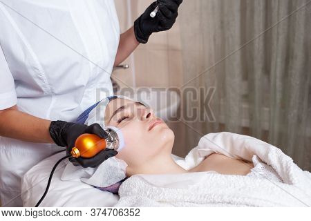 The Beautician Performs The Procedure Of Electroporation