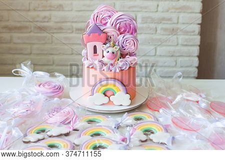 Pink Birthday Cake With Fondant Unicorn, Rainbow And Meringue Clouds. Candy Bar With Cake, Cookies A