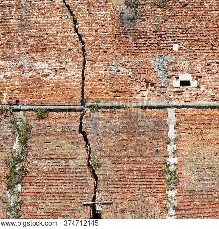 Cracked Brick Wall - Deep Crack In A Brick Wall