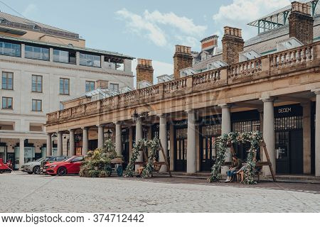 London, Uk - June 13, 2020: Few People Relaxing On Flower Decorated Benches In Empty Covent Garden M