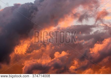Clouds Lit By The Sun At Sunset. Picturesque Clouds In The Sky Backlit By The Sun.