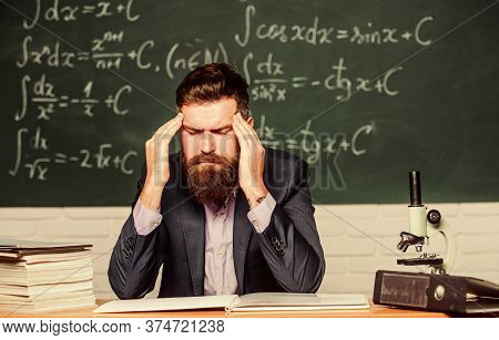 Terrible Headache. Teacher Has Headache. Bearded Man Suffer From Headache. Headache And Migraine. He