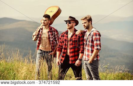 Adventurers Squad. Long Route. Tourists Hiking Concept. Hiking With Friends. Men With Guitar Hiking