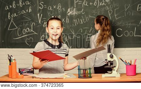 Pupils At Chalkboard. Fascinating Science. Educational Experiment. Formal Education School. Back To