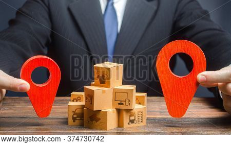 The Businessman Indicates The Points Of The Route Of Supply And Delivery Of Goods. Distribution. Tra