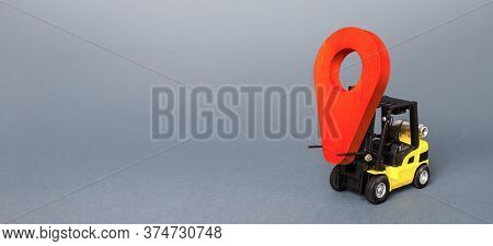 Forklift Carries A Red Pin Location Navigation Symbol Pointer. Transportation And Delivery Services.
