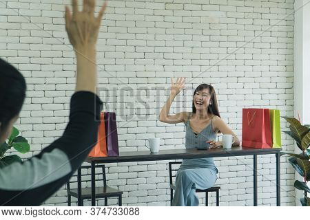Two Asian Women Who Are Laughing And Attractive Are Friends, Talking About Coffee In A Cafe. Beautif