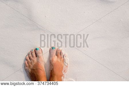 White Sand Texture Woman Feet. Relaxed Tourist On Beach. Tropical Vacation Banner Template With Text