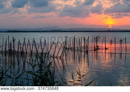 Sunset Over Albufera Freshwater Lagoon And Estuary On The Gulf Of Valencia Coast, Spain
