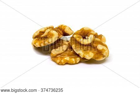 Natural Walnut On White Background. Cracked And Cleaned Nut Seeds. Simple Organic Food. Tasty Health