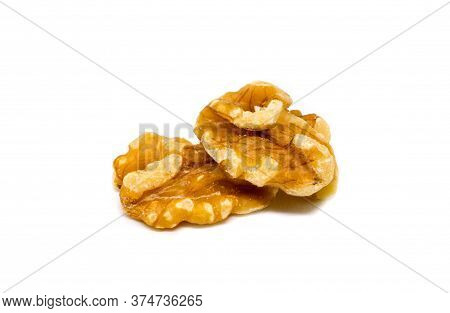 Natural Walnut On White Background. Cracked And Cleaned Nut Kernel. Organic Food Studio Photo. Tasty