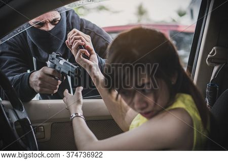 Dangerous In The City. Robber Pointing Gun To Victim In The Car And Try To Rob Mobile Phone From Her