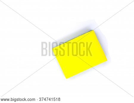 New Yellow Sponge For Dish Or Car Washing. Cleaning Sponge Top View Photo On White Background. Janit