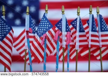 4th of July. American Flags with American Flag Background. America's Independence Day is the day to Celebrate our heritage and Independence from British Rule. Happy 4th of July.