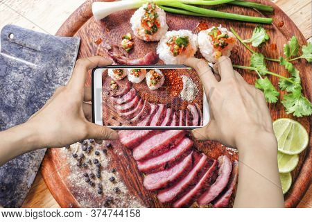 Girl Taking Pictures On Mobile Smart Phone A Thai Style Bbq Grill Meat And Sticky Rice With Spicy Sa