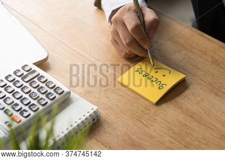 Entrepreneur Mindset Create Goal Before Start Project. Businessman Writing Word Success On Yellow Pa