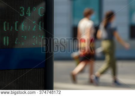 Bucharest, Romania - June 30, 2020: 35 degrees celsius (92 fahrenheit) is the temperature displayed by a digital thermometer on a hot summer on a street in downtown Bucharest. Image for editorial use.