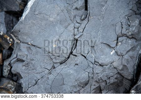 Black Texture. Rough Structure. Stone Black Wall. Rock Texture. Stone Background. Black Background.