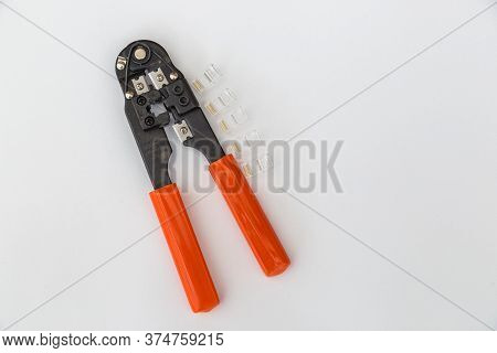 Crimping Rj45 Lan Cable On A White Background.