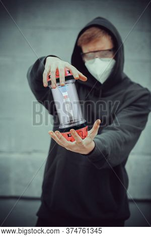 young guy with protective capsule for transporting blood tubes