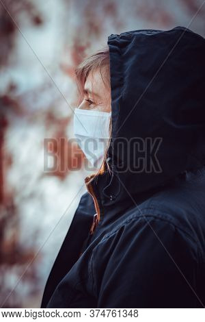 woman in protective mask during pandemic