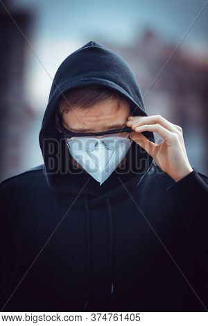 Masked young guy during a pandemic