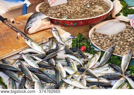 Fish And Clams And Chopping Board Seen At A Market In Naples, Italy