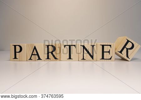 Partners Word Written On Wood Block. Partners Text On Wooden Table.