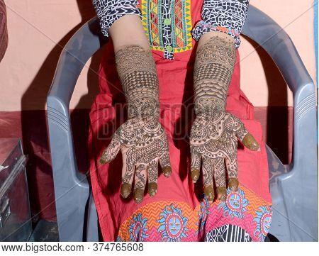 The Beautiful Mehndi Design On A Girl Hand