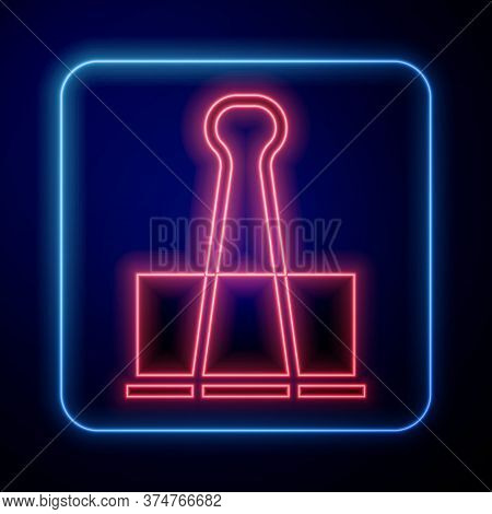 Glowing Neon Binder Clip Icon Isolated On Blue Background. Paper Clip. Vector Illustration