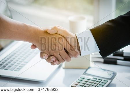 Concept Signing Business Contract, Close Up Above View Of Businessman And Client Shaking Hands After