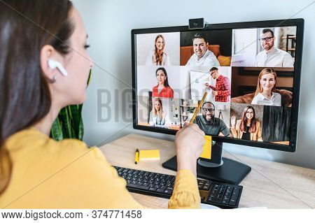 Back View Of Pc Display With A Group Of Multiracial People On It, Young Woman Watching Online Webina