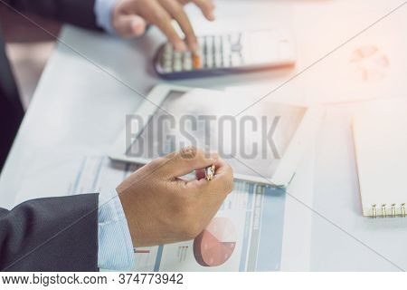 Entrepreneur Calculate Financial Cost. Businessman Planning To Extend Business And Calculating Budge
